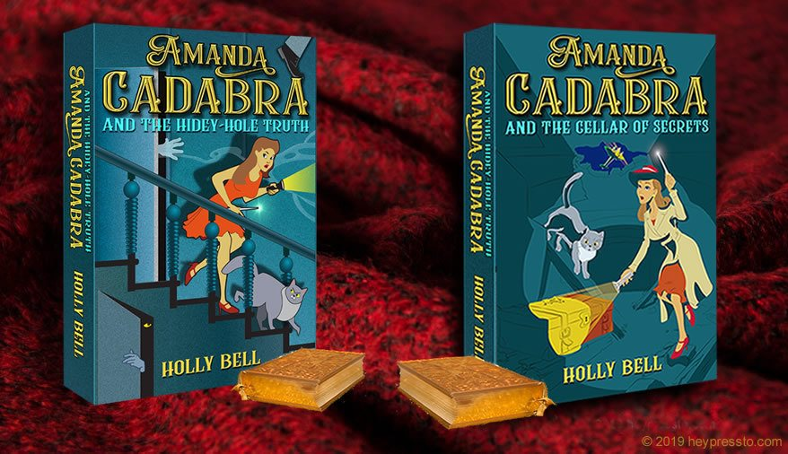Amanda Cadabra Book 1 and 2 with a little gold book in front of each, on a cozy dark red woolen background
