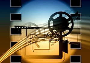 gold and blue background with film and projector graphics