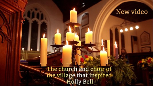 Candles in a church. Link to new church and choir video. Text: The chuch and choir of the village that inspired Holly Bell