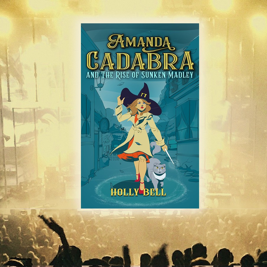 Audience, stage with cover of Amanda Cadbar and The Rise of Sunken Madley. Amanda with wand in hand, pointing at the ground, stands with her cat beside her in a ring of salt. It is a stormy afternoon, she holds her witch's hat with her left hand. The village is in the background and at either side