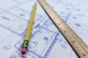 blue prints iwth yellow pencil with red rubber top and ruler
