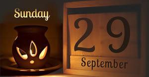 wooden date blocks in candle light 29 September Sunday