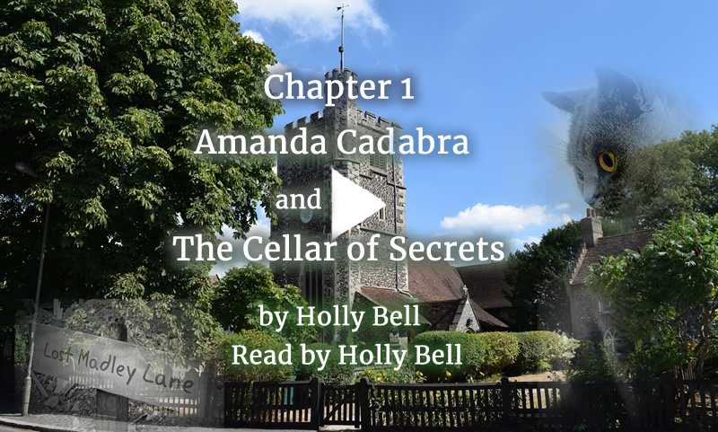 Link to video of cozy mystery Book 2 Chapter 1, from Amanda Cadabra and The Cellar of Secrets: old village church surrounded by trees. Text: Amanda Cadabra and The Cellar of Secrets by Holly Bell