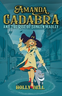 Cover for Amanda Cadabra and The Rise of Sunken Madley a young woman in a cream coat over an orange dress holding on to witch's hat and wand standing on old village streee with grey cat beside her and storm above