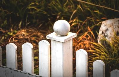 little white fence on garden border