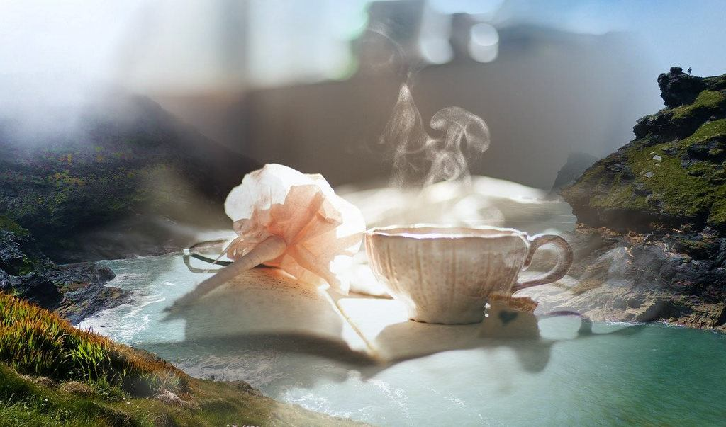 Cornish connect - to a coz mystery?flower and steaming cup on book fading into Cornish scenery