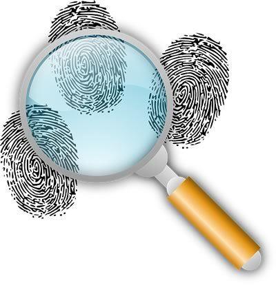 Clues: Magnifying glass over 3 fingerprints