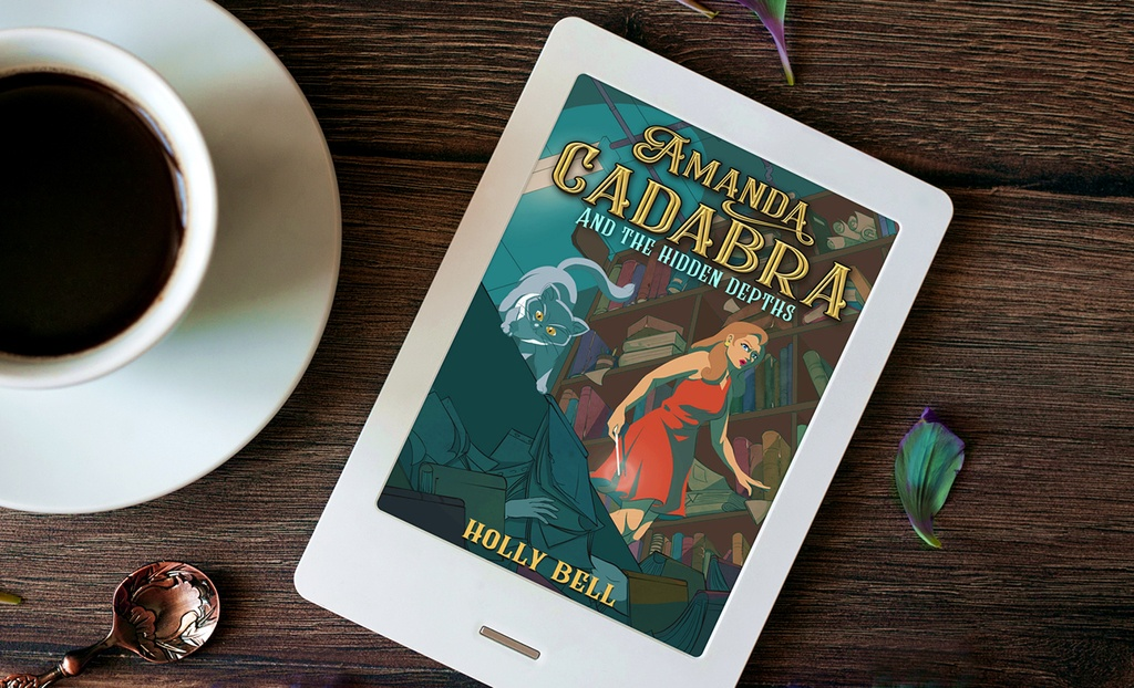 Amanda Cadabra Book 5 on e reader on wooden table next to edge of cup and saucer