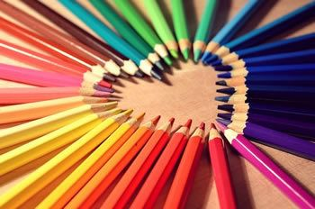 Coloured pencils with tips forming a heart shape