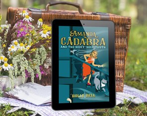 ebook in ereader Amanda Cadabra and The Hidey-Hole Truth, leaning on a picnic basket with wild flowers on the left