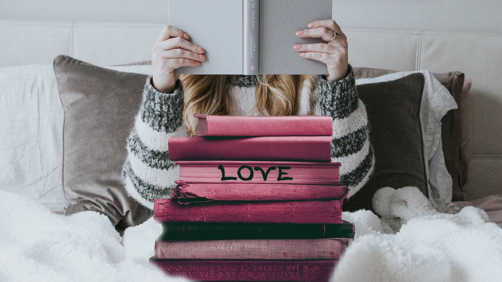 Girl reading in bed, grey book hides her face as she reads. In foreground is a pile of red books and on one spine is the word Love.