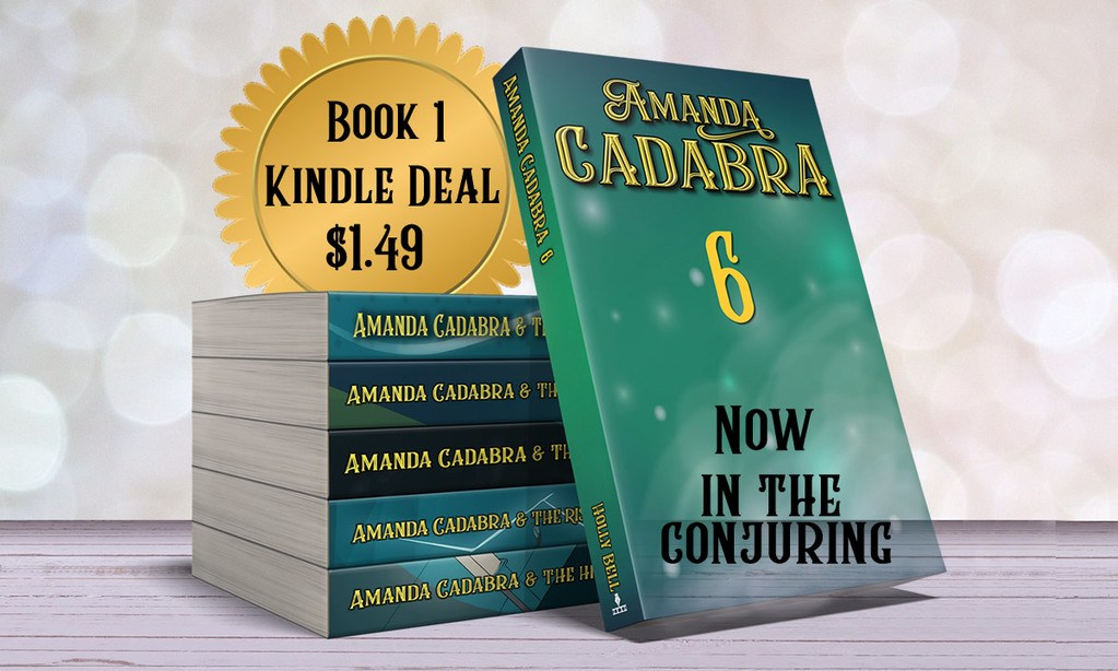 Pile of Amanda Cadabra paperback 1-5 with Book 6 leaning against it. Amanda Cadabra 6. Partly transparent. :text Now in the conjuring. It top left a golden disk with text: Book 1 Kindle Deal $1.49