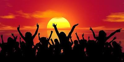 Celebration, silhouette of people dancing against sunset/sunrise