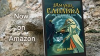 Amanda Cadabra and The Strange Case of Lucy Penlowr by Holly Bell in ereader leading against granite stone. Text: Now on Amazon. Link image to trailer.