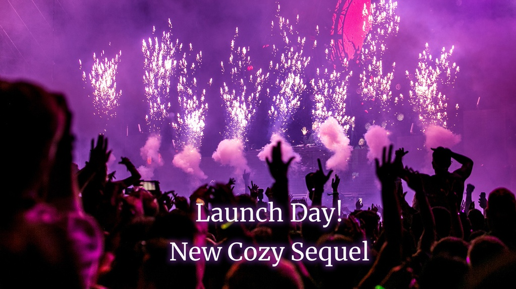 Crowd in silhouette, fireworks against purple lighting. Text: Launch Day! New Cozy Sequel
