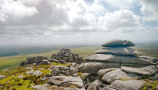 Tor on Bodmin Mor looking out over green wild landscape