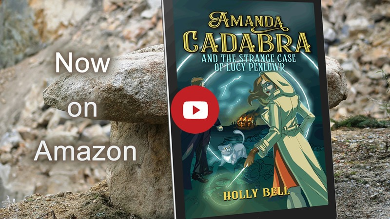 Link image to video of trailer for Amanda Cadabra and The Strange Case of Lucy Penlowr. Book leaning on Cornish granite. Text: Now on Amazon